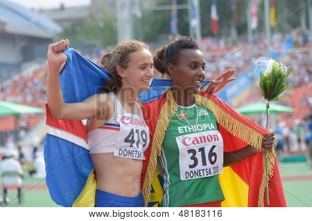 DONETSK, UKRAINE - JULY 14: A. Hinriksdottir, Iceland (left) and D. Edao, Ethiopia win medals in the final on 800 meters during 8th IAAF World Youth Championships in Donetsk, Ukraine on July 14, 2013