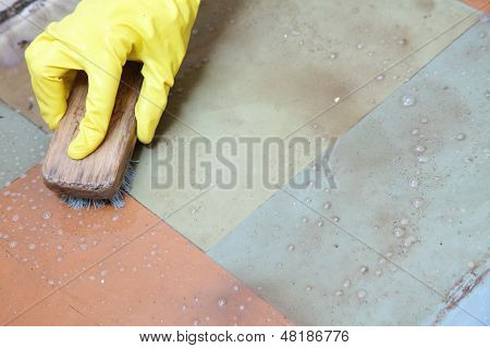 Gloved Hand Cleaning Of Dirty Filthy Floor