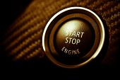 Detail on the start button in a car poster