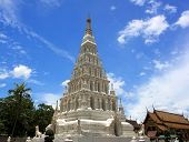 """White Triangle Pagoda at ancient buddhist temple """"Wat Chedi Liam"""" at Wiang Kum Kam Chiangmai Thailand. poster"""