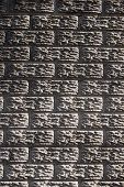 A flat view of a section of concrete precast fencing in the form of a bricked wall poster