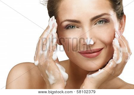 Beautiful Woman Cleaning Her Face With A Foam Treatment