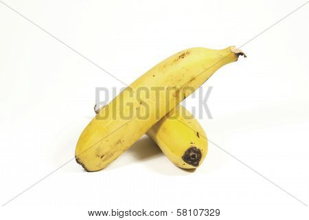 Two Isolated Ripe Yellow Bananas On White