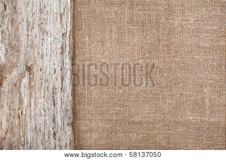 Burlap Background Bordered By Old Wood