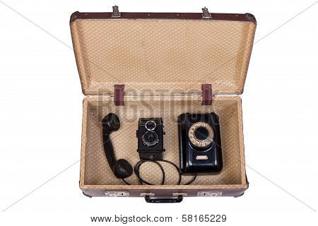 Rotational Phone And  Film Camera In An Old Suitcase