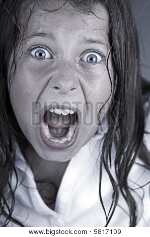 Close Up Shot Of A Child Screaming