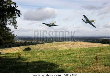 Two mustangs flying over rural farmland
