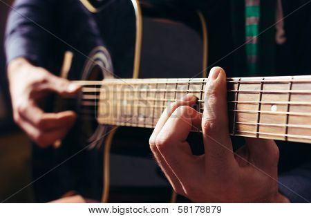 Man Playing Music At Black Wooden Acoustic Guitar
