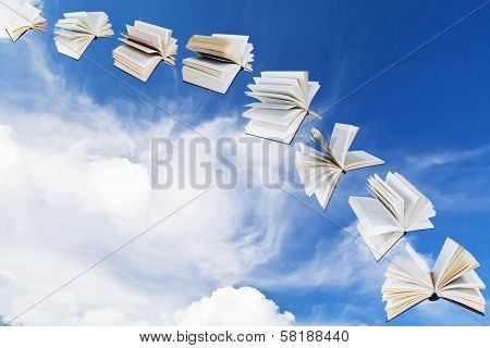 Arch Of Flying Books With Blue Sky
