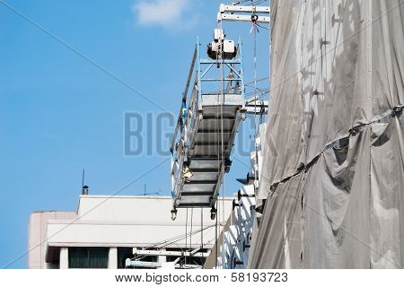 Empty Hanging Scaffold Under Blue Sky