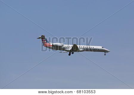 American Eagle Embraer ERJ-145 in New York sky before landing at JFK Airport