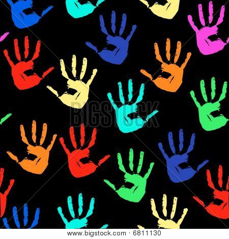 Seamless a background with multi-coloured prints of hands
