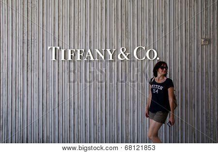SANTA MONICA, CALIFORNIA - TUES. JUNE 24, 2014: A woman walks past a Tiffany & Co. jewelry store in Santa Monica, California, on Tuesday, June 24, 2014.