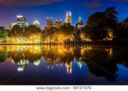 The Atlanta Skyline Reflecting In Lake Clara Meer In Piedmont Park In Atlanta, Georgia.