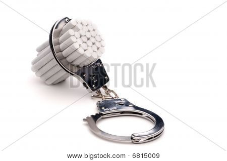horizontal image of handcuffs around cigarettes : addiction