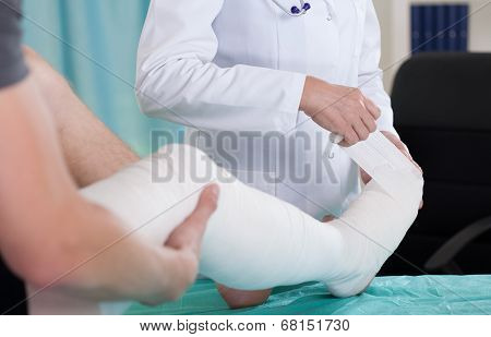 Patient with leg in a plaster cast poster