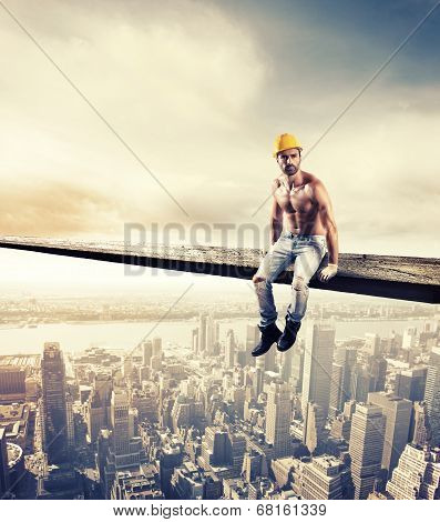 Sexy mason at work over modern cityscape poster