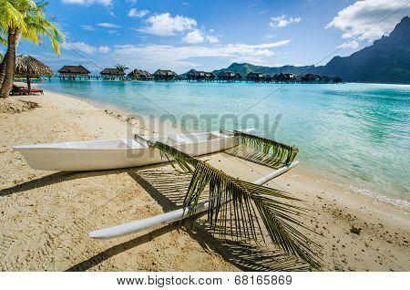 Outrigger canoe on the beach in the tropics