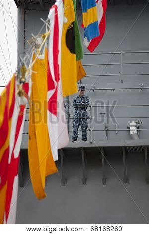 NEW YORK - MAY 22: Armed U.S. Navy personnel patrol the amphibious dock landing ship USS Oak Hill (LSD 51) moored at Pier 92 for Fleet Week NY on May 22, 2014.