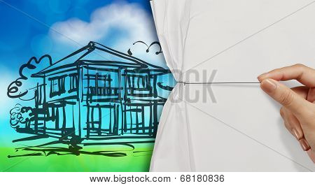 Hand Open Crumpled Paper To Show Dream House And Green Nature Background As Concept