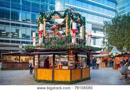 Canary Wharf square, traditional fun fair with stools, cafe, prises to win and Christmas activity.