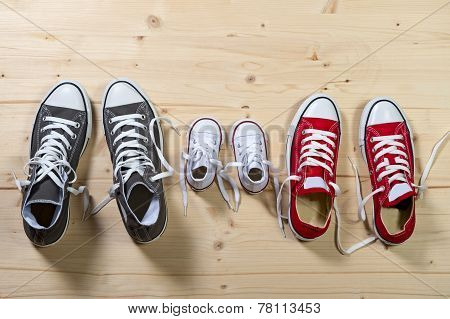 Three Pair Of Shoes In Father Big, Mother Medium And Son Or Daughter Small Kid Size In Family Togeth