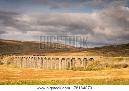 The Ribblehead Viaduct carries the Settle to Carlisle Railway across Batty Moss spanning 400 m and 32 m above the valley floor poster