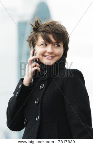Woman On Cellphone In Windy Day