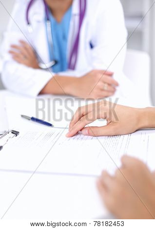 Doctor and patient sitting on the desk  at office, isolated