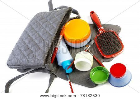 Female Bag And Cosmetics Isolated On A White Background