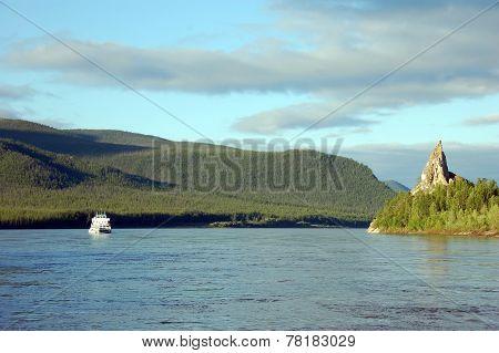 Cargo Ship And Rock At Kolyma River Russia