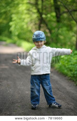 Little Boy In A Forest