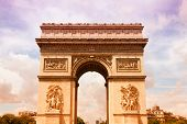 Paris France - famous Triumphal Arch (Arc de Triomphe) located at the end of Champs-Elysees street. UNESCO World Heritage Site. Filtered style colors. poster