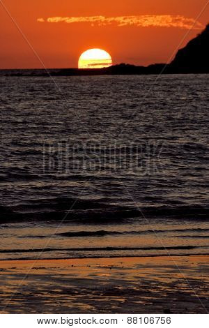 sunset near a mountain in nosy be madagascar poster