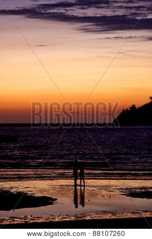 sunset near a mountain in nosy be madagascar and two people in the beach poster