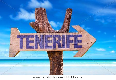 Tenerife wooden sign with beach background