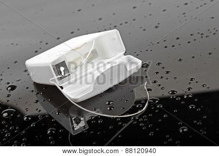 Dental Floss On Black Wet Surface