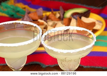 Margaritas with platter of corn chips on Mexican table cloth. Ready for a Cinco de Mayo project.