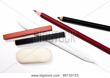 Different Kinds Of Art Tools: Pencils, Eraser, Stamp, Chalk Of Sanguine And Charcoal.