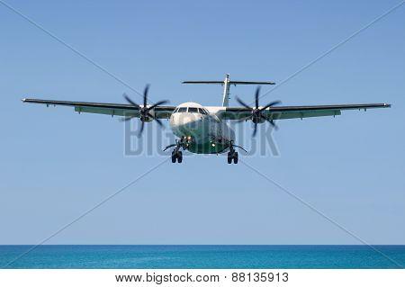 Turboprop Aircraft Atr 72, Landing In Phuket International Airport In Thailand