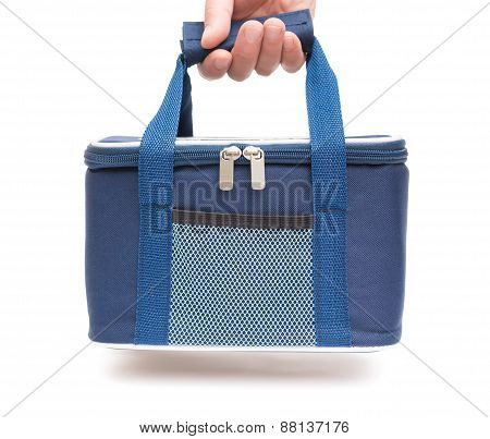 Hand Carrying A Blue Lunch Pack Carrier  With Clipping Path
