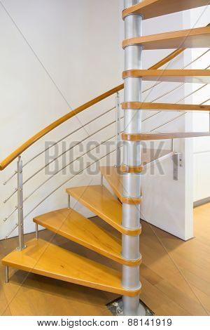 Morden Spiral Stairs With Wooden Steps Inside A House