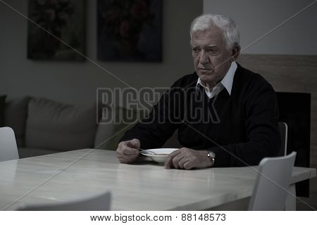 Aged depressed man and his lonely dinner poster