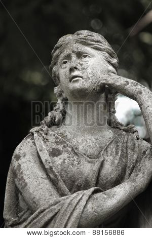 Statue of woman on tomb as a symbol of depression pain sorrow and death poster