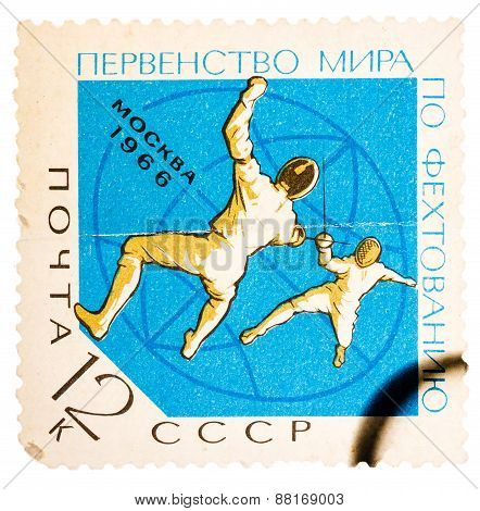 Stamp printed in the USSR Russia shows two fencers with inscri