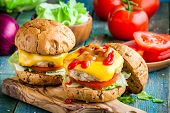 homemade burgers with chicken cutlet cheddar cheese fresh tomatoes and lettuce poster