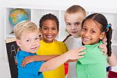a group of little preschool friends hugging in a circle in classroom poster