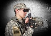 soldier with gun on a gray background poster