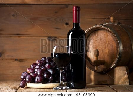 Red wine on wooden background