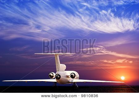 Jet Airliner On Ground And Stunning Sunset